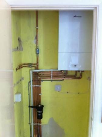 New 28kw Junior WB boiler, neatly fitted in bedroom Cupboard – Southmoor June 15